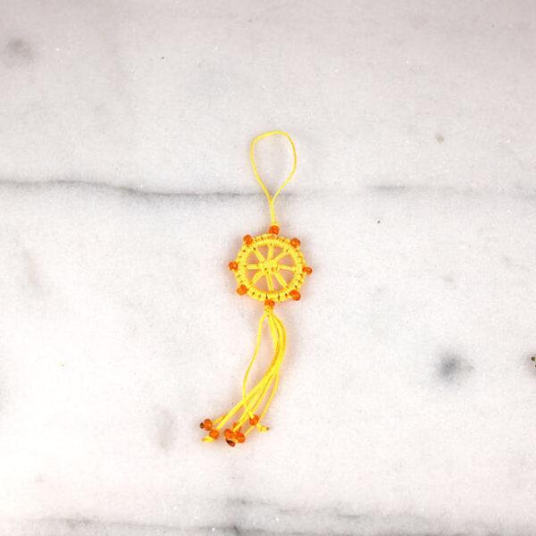 rueda de dharma amarilla 2 — Humos.cl